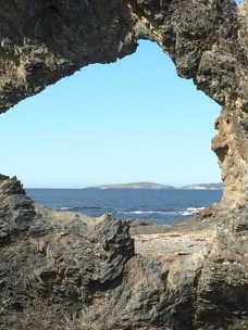 Montague Island seen through Australia Rock in Narooma