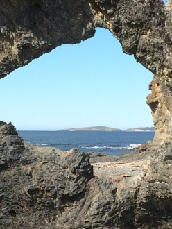 Montague Island seen through Australia Rock in Narooma